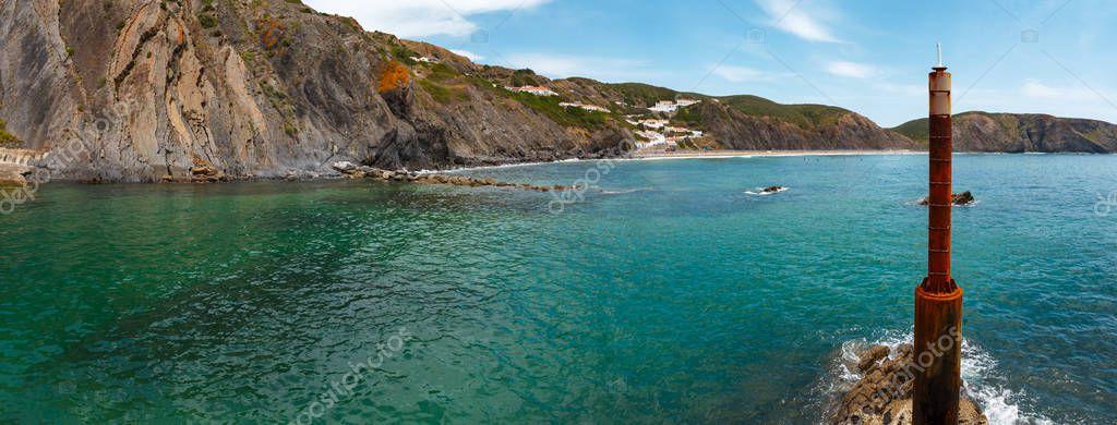 Summer sandy Arrifana Beach (Aljezur, in Algarve, Portugal).