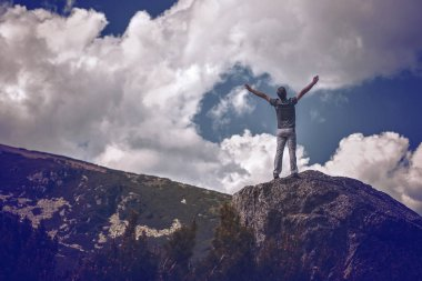 Active young amn gesture success after climbing a mountain