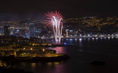 Las Palmas, Spain - June 24: Thousands of tourists and locals flock to Las Canteras town beach to watch midnight fireworks of Night of San Juan, on June 24, 2018 in Las Palmas de Gran Canaria, Spain