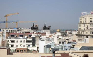Madrid, Spain - August 08: Sky over Madrid bleached by dust and heat of the summer, view from Circulo de Bellas Artes gallery rooftop terrace, in the middle of heatwave, on August 08, 2018 in Madrid, Spain