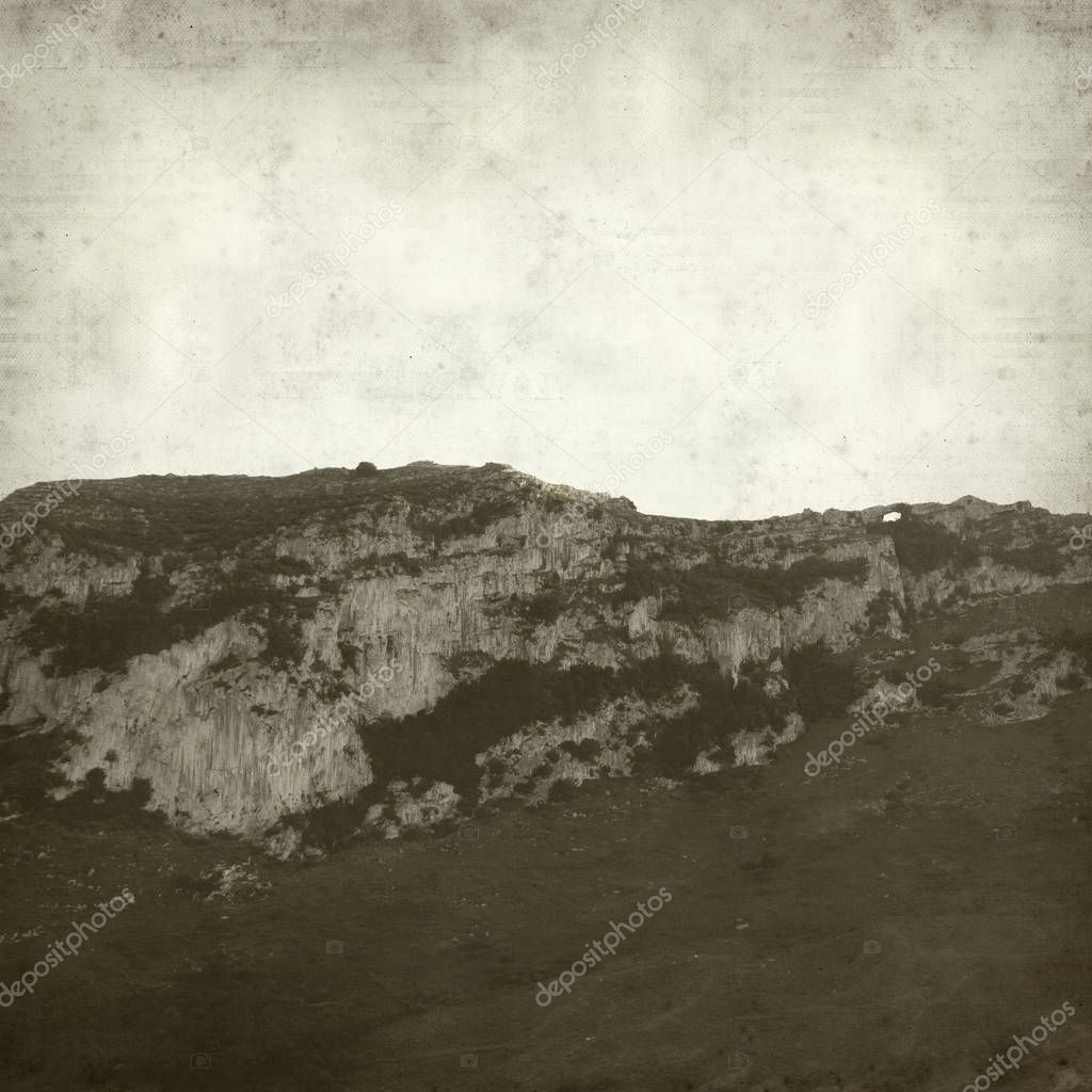 textured old paper background with landscape of Cantabria, Northern Spain