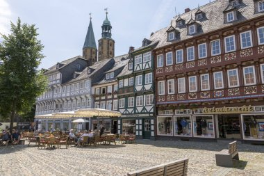 Goslar, Germany - July 08, 2018: Residents and guests of the city relax in a cafe in the center of Goslar, Germany