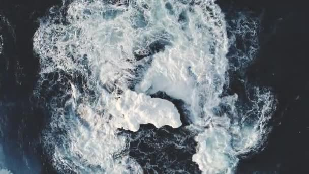 Aerial drone shot over surf waves in Antarctica