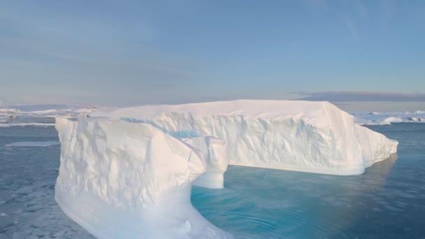 Antarctica big iceberg float aerial tracking view