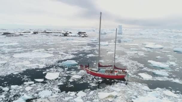 Sailing yacht Sail in arctic dangerous frozen ocean