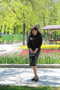 Beautiful charming model in the spring park in Moscow, Russian Federation.