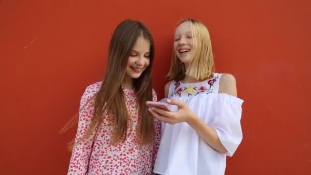 Beautiful caucasian teen girls are chatting