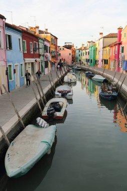 BURANO, VENETO, ITALY - APRIL 21, 2019: Colorful Burano island at sunset.