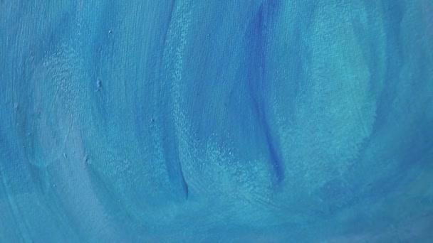 Kéz festett kék akril textúrájú háttér, mint egy absztrakt kortárs művészeti festészet. Kijelölt fókusz. A bokeh blur.