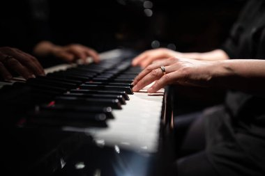 Close up of hands of a female piano player
