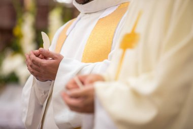 Priest' hands during a wedding ceremony/nuptial mass