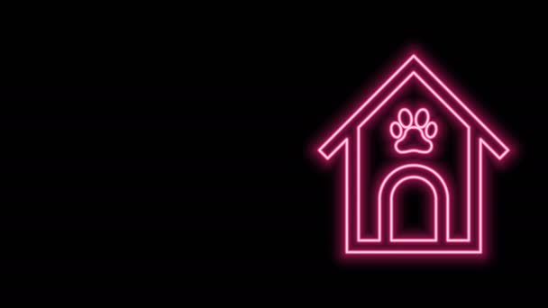 Glowing neon line Dog house and paw print pet icon isolated on black background. Dog kennel. 4K Video motion graphic animation