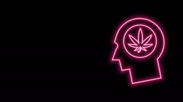 Glowing neon line Silhouette of male head in profile with marijuana or cannabis leaf icon isolated on black background. Marijuana legalization. Hemp symbol. 4K Video motion graphic animation