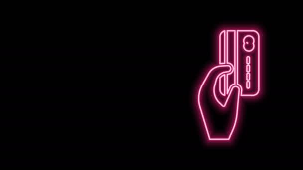 Leuchtende Leuchtschrift Menschliche Hand mit Kreditkartensymbol isoliert auf schwarzem Hintergrund. Online-Zahlung. Bezahlen Sie mit Karte. Finanzgeschäfte. 4K Video Motion Grafik Animation