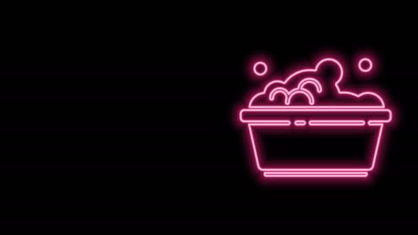 Leuchtende Neon-Linie Plastikbecken mit Seifenlauge Symbol isoliert auf schwarzem Hintergrund. Schüssel mit Wasser vorhanden. Wäsche waschen, Ausrüstung reinigen. 4K Video Motion Grafik Animation