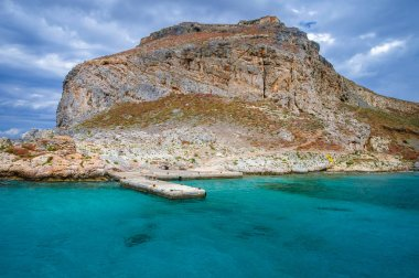 Imeri Gramvousa Island with ruins of Venetian fort on a Mediterranean Sea near island of Crete, Greece