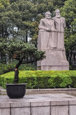 Statue of Karl Heinrich Marx and Friedrich Engels in Fuxing Park in the former French Concession of Shanghai in Luwan District