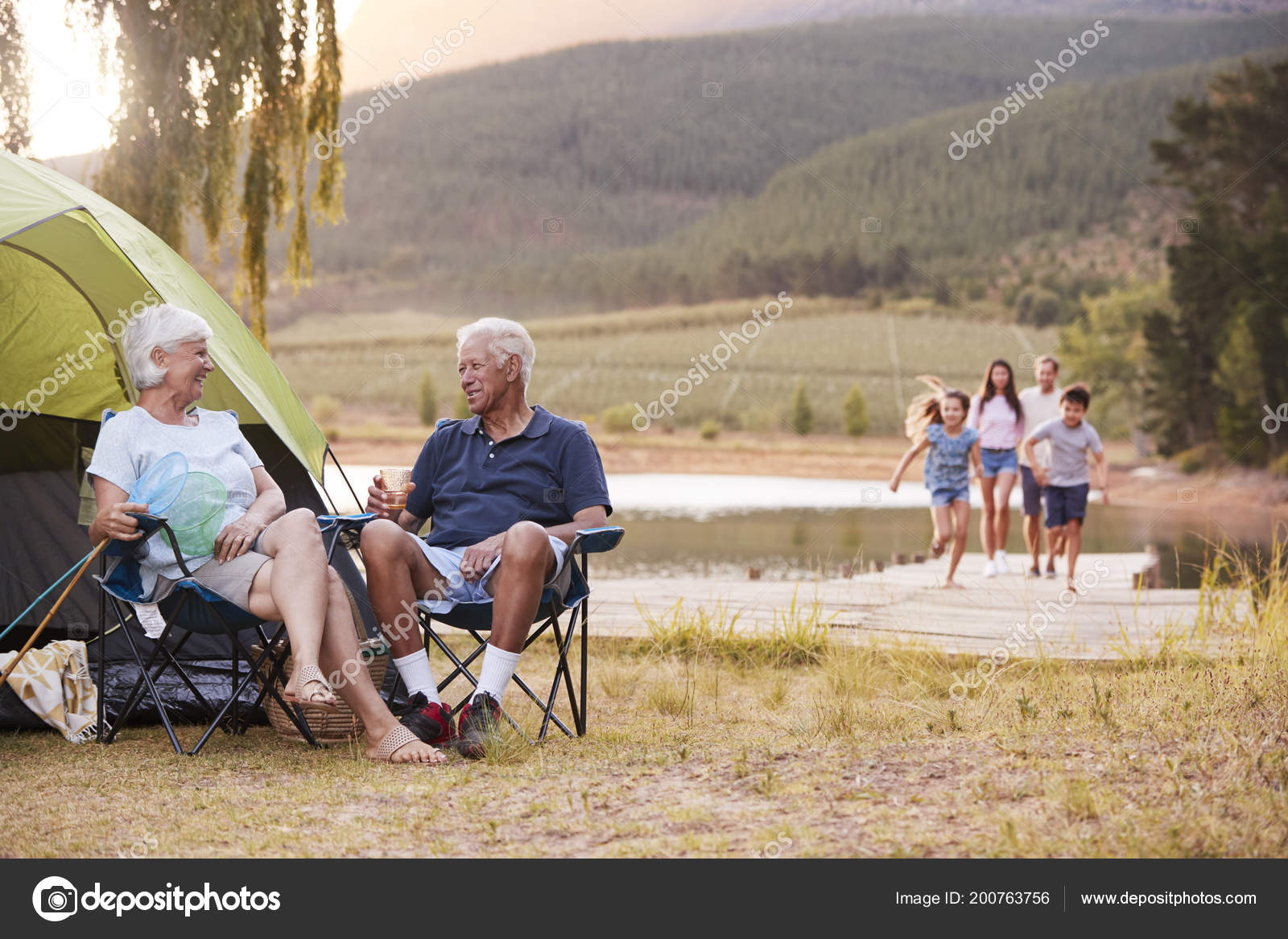 multi generation family camping trip lake together stock photo