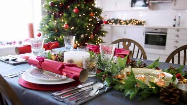 Dining Table Prepared For Christmas Dinner With A Christmas Tree And Kitchen Background Close Up Shot Moving Around The Table