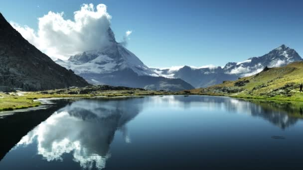 Reflection of Matterhorn in lake Riffelsee, Zermatt, Switzerland