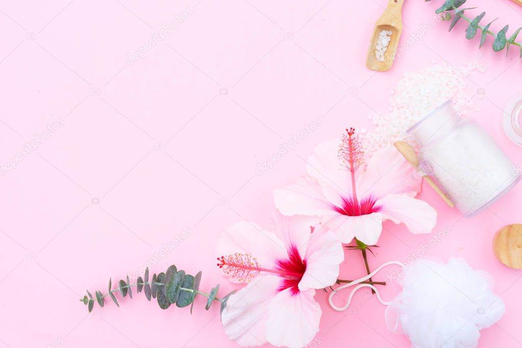 Beauty background with a natural soap, cream, towels and hibiscus flowers