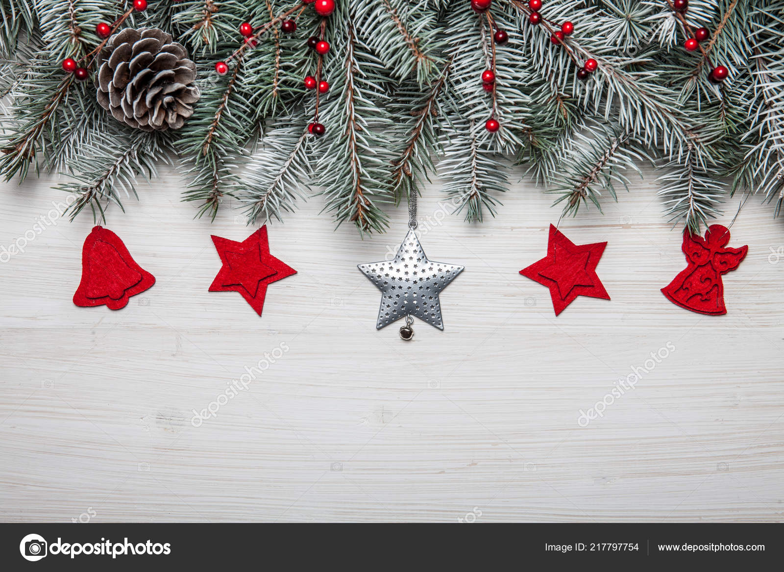 b337225274f1 Christmas card. White wooden background with snow fir tree and decoration.  Top view with copy space for your text– stock image