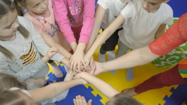 Childrens playroom. Childrens hands on top of each other.