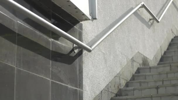 climb the gray stairs with railings