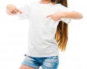 Little girl in casual white T-shirt on white backgtound.