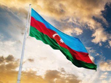 Azerbaijan flag against sunset sky