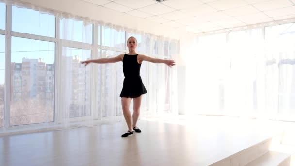 Young attractive ballerina practising ballet moves