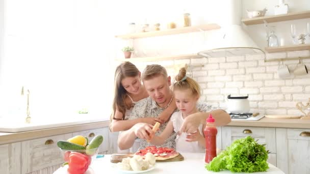 Father and daughters having a fun in the kitchen