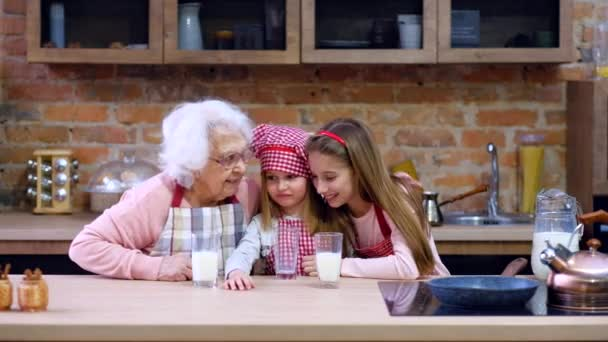 Sisters with grandmother sitting at table