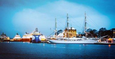 Vessels docked in harbor in the evening, Bergen, Norway