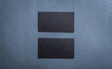Black blank business card template on dark background.