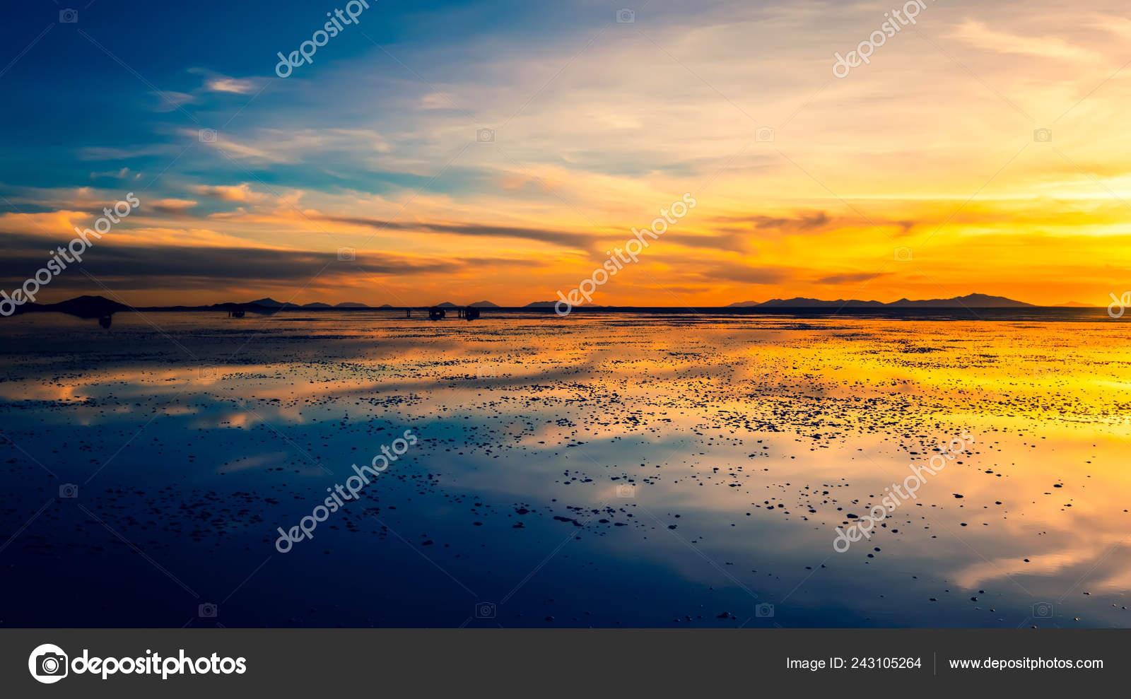 Evening Landscape Of Salar De Uyuni Sunset Stock Photo