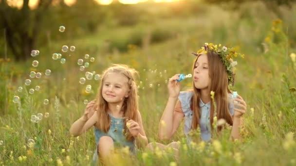 Litlte Girls Blowing Bubbles