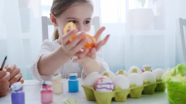 Kid is showing her Easter decorations