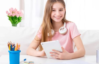 Girl with tablet relaxing