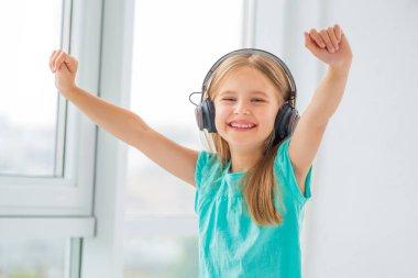 Happy little girl in headphones