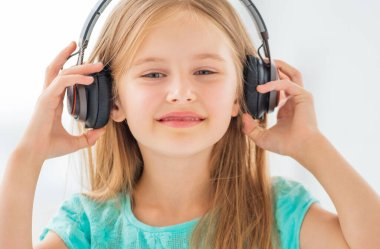 Portrait of school girl with headphones