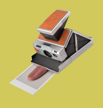 Instant film camera with print of a tongue