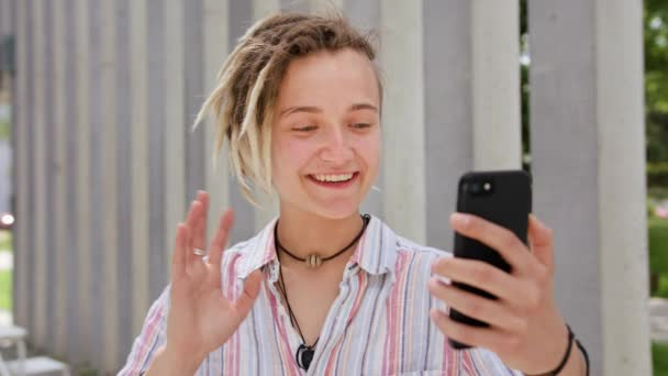 Young Lady With Modern Hairstyle Using Phone In Town Stock Video