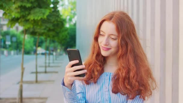 Lady Using a Phone Outdoors