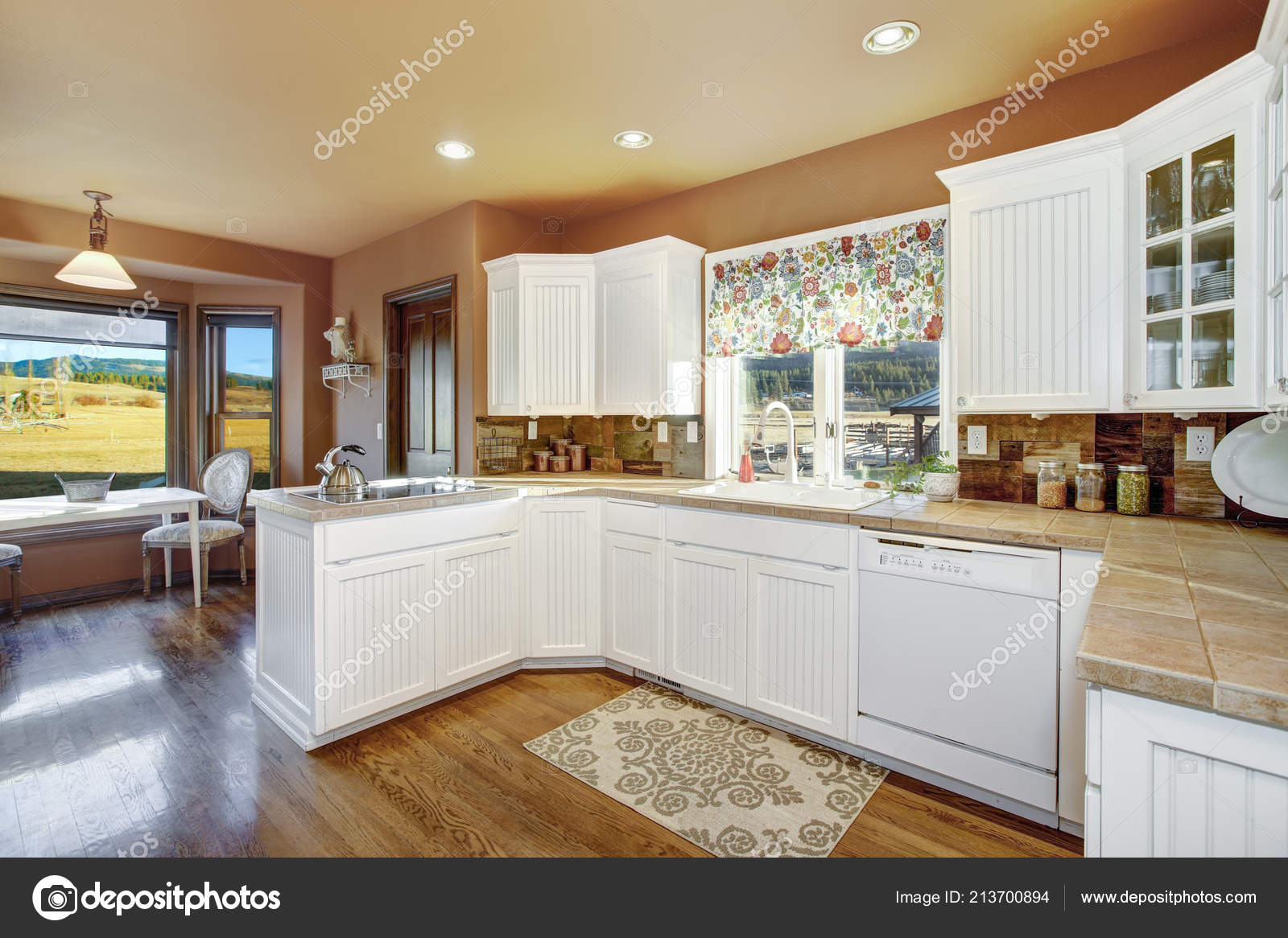 Country Kitchen Features White Cabinets Tile Countertop Rustic Plank Backsplash — Stock Photo