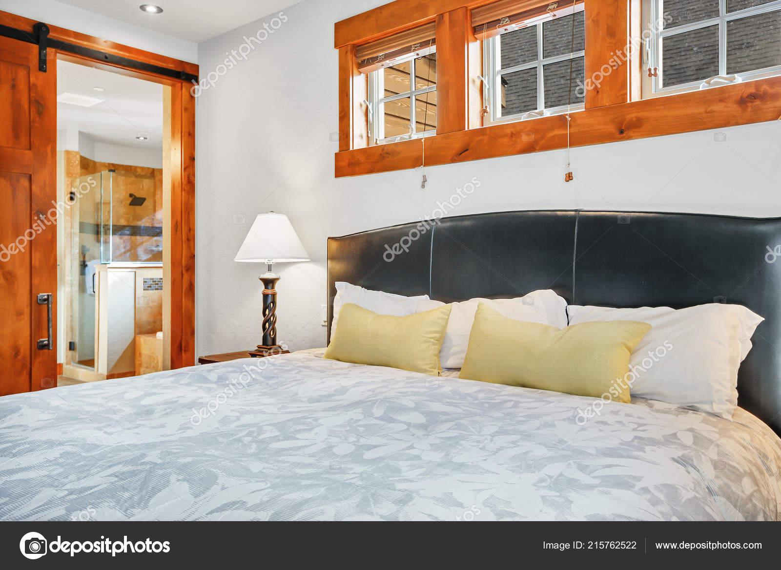 Gorgeous Master Bedroom Interior Leather Headboard Wood Trim Barn Doors Stock Photo C Iriana88w 215762522