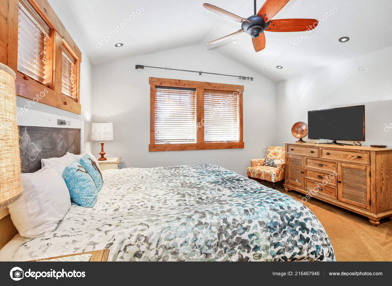 Image of: White Vaulted Ceiling With Wood Beams Light Filled Bedroom White Walls Vaulted Ceiling Blue Bedding Stock Photo C Iriana88w 216467946