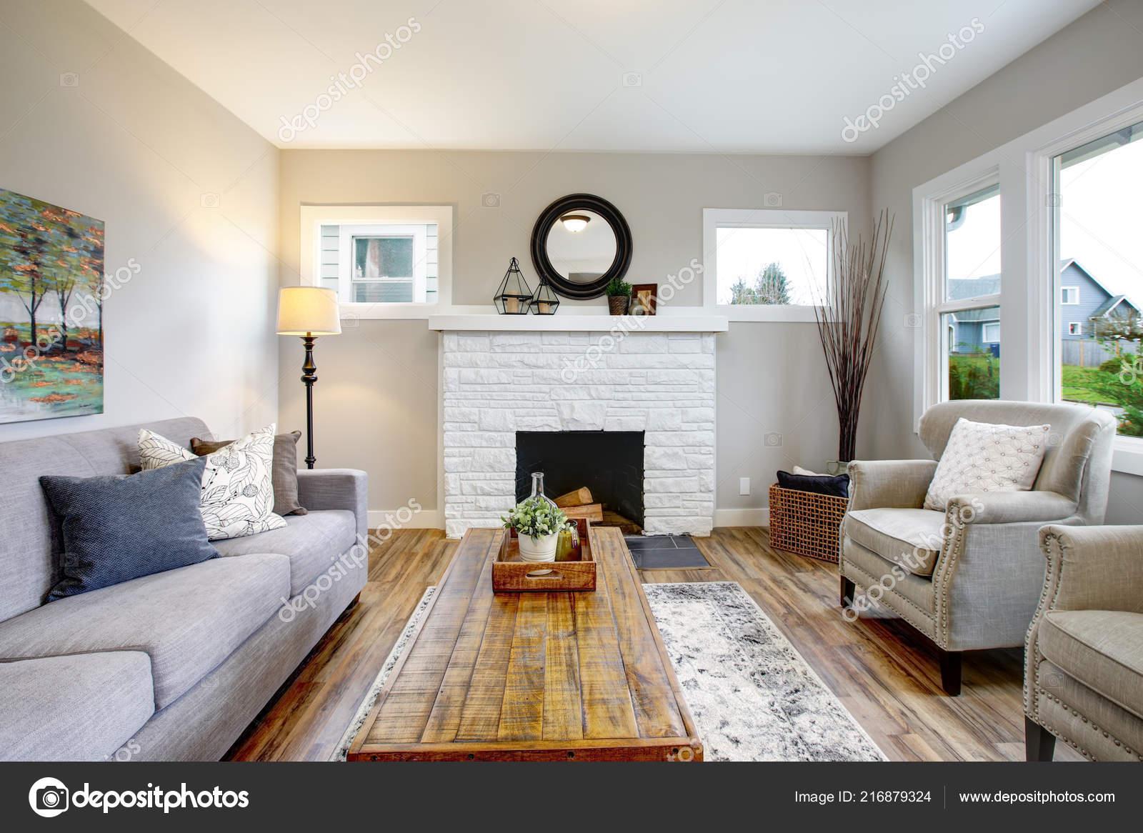 Spacious Living Room Traditional Fireplace Grey Sofa Two