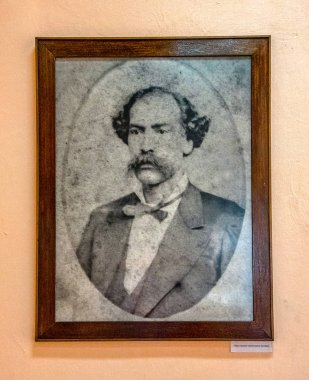 Major General Vicente Garcia Gonzalez old photograph on a wall of his natal house.