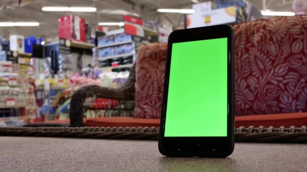 Motion of green screen phone in front of display sofa inside the Canadian  tire store